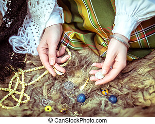 A young girl prepares some things for witchcraft