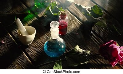Witchcraft. Witch doctor desk table. Magic potion. ALternative medicine concept. Divination, love potion. Mysterious clouds of smoke
