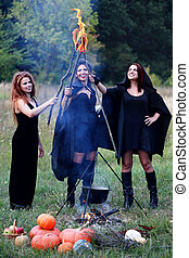 witches holding torches