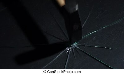 With a light hammer blow, the glass is broken into particles. Slow motion