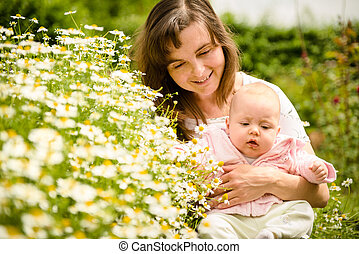 With baby in nature