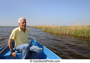 With boat in nature
