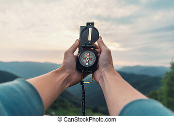 With compass in mountains - Traveler young woman searching...