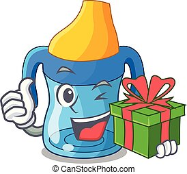 With gift cartoon baby drinking from training cup