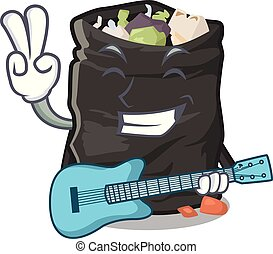 With guitar cartoon garbage bag next to table vector illustration