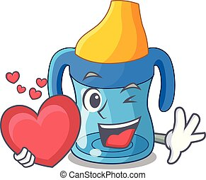 With heart cartoon baby drinking from training cup