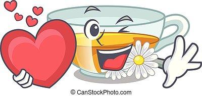 With heart chamomile tea in the cartoon shape