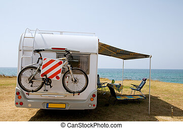 With mobile home on vacation