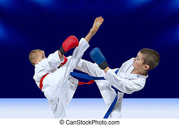 With overlays on the hands the boys are training blows legs