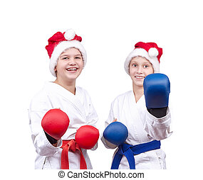 With red and blue overlays on the hands children stand in the rack karate