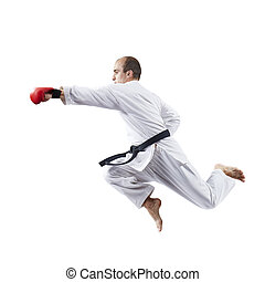 With red overlays on hands, an adult sportsman strikes with a hand against a white background