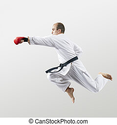 With red overlays on the hands adult athlete beats with a hand in the jump