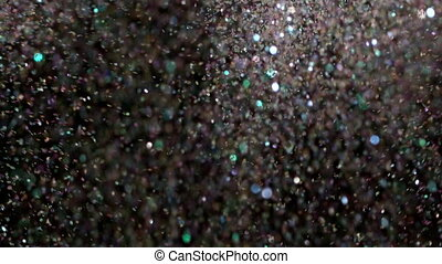 Realistic Glitter Exploding on Black Background. - With the...