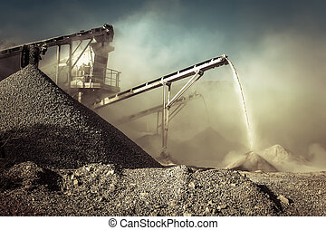 With working gravel crusher. Industrial background - ...