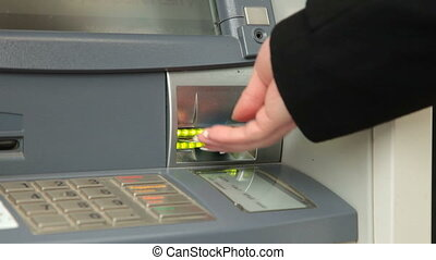 Withdrawing Money From ATM Machine - Female Hand Withdrawing...