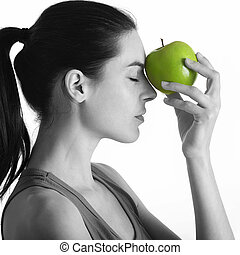 withe and black portrait with green apple