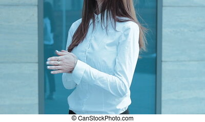 without face woman rubs hands in the street