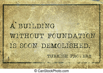 A building without foundation is soon demolished - ancient Turkish proverb printed on grunge vintage cardboard