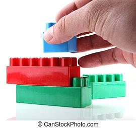 witte , speelgoed belemmert, achtergrond, plastic