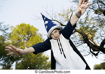 Wizard Boy with hands outstreached - Young boy in a wizard ...
