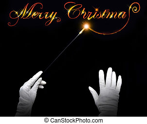 Merry Christmas - Wizard hands drawing 'Merry Christmas' on...
