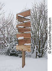 Wodden Signpost With Snow In Winter