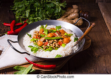 wok pan with meat strips and vegetables