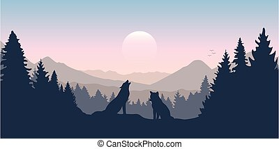wolf pack in forest with mountain landscape