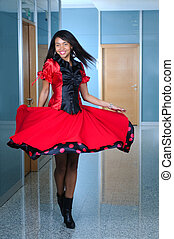 woma in red dres dancing