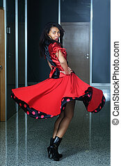 woma in red dress dancig