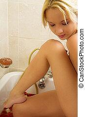 Woman #33 - Nude woman in a bath.  Looking down.