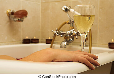Woman #95 - Woman in a bath, holding a champagne glass.