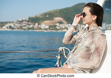 woman aboard a boat looking at the sea