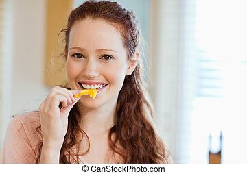 Woman about to bite into bell pepper