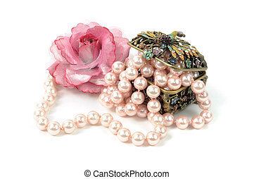 Accessory and pearl necklace on white background