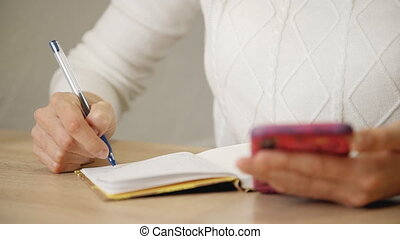 Woman accounting bill at home. Female household sitting at...