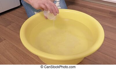 Woman add detergent in water