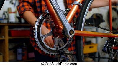 Woman adjusting bicycle paddle 4k - Woman adjusting bicycle...