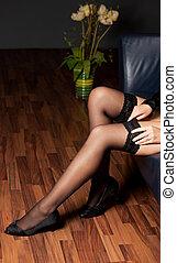 stockings - woman adjusting her stockings