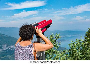 woman admires Lake Annecy at the Col de la Forclaz - A woman...