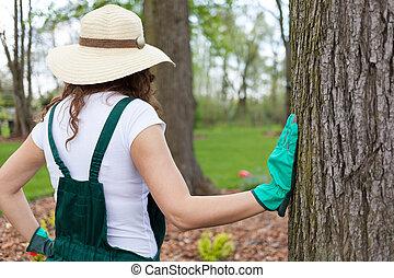 Woman admiring her beautiful garden