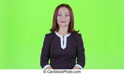 Woman advertises clothes. Green screen