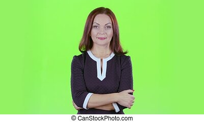 Woman advertises the products and shows a thumbs up. Green screen