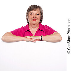 Woman advertising blank banner ad