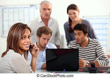 woman advising a group  of people possibly a family