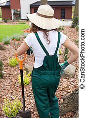 Woman after digging flowerbeds