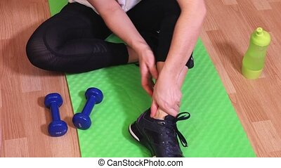 Woman after work out with ankle injury