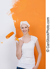 woman against half painted wall
