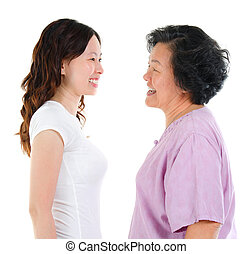 Ageing concept. Asian senior mother and adult daughter face to face, profile side view smiling isolated on white background.