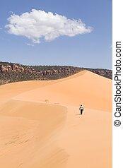 Woman alone in Coral Pink Sand Dunes, Utah